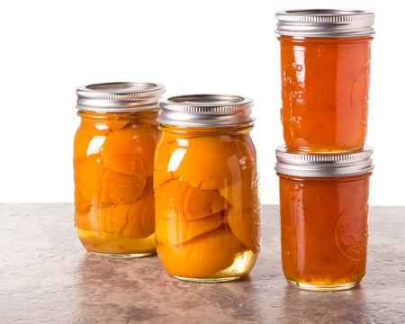 Fresh apricots preserved as homemade jam and in mason jars Stok Fotoğraf