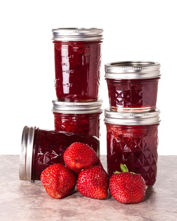 Fresh strawberries preserved in jars as homemade jam and jelly Stock Photo