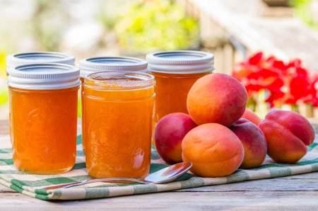 preserving: Jars of homemade apricot jam or preserves Stock Photo
