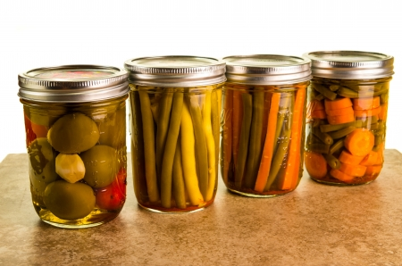 Homemade jars of preserved vegetables stored in mason jars photo