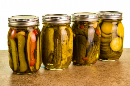Homemade pickles in mason jars on a kitchen counter photo