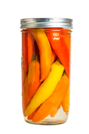 Fresh home canned preserved peppers in brine in mason jars photo