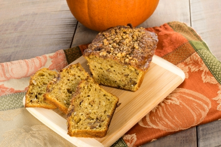 Pumpkin walnut bread freshly made on bamboo cutting board