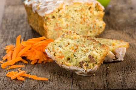 carrot cakes: Carrot apple cake on wooden table with shredded carrots