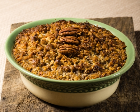 Home made baked sweet potatoe casserole with pecan topping Imagens