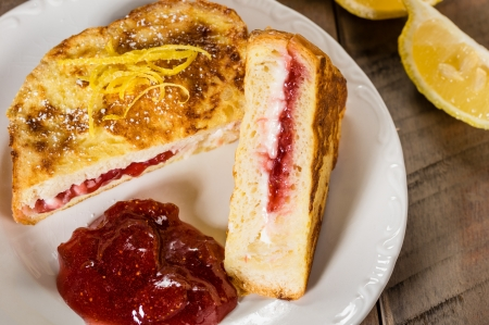 Breakfast of stuffed French toast with strawberry and cream cheese filling with lemon zest