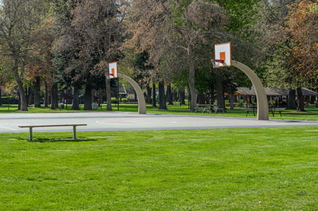 A basketball court in a public park for recreation