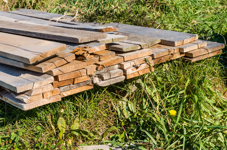 Stack of wood lumber weathered and used