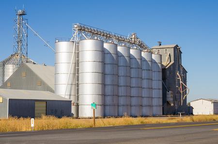 Metal silos and grain elevators at a rural mill