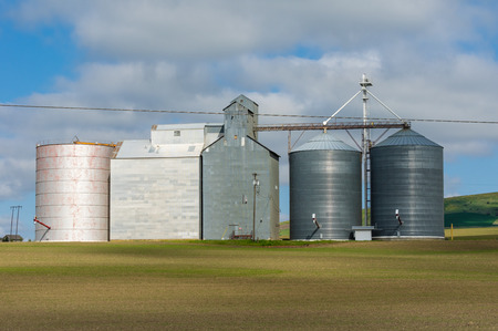 Group of grain storage buildings and silos in a rural area Stock Photo
