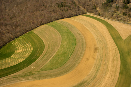 cropping: Aerial view of farm fields using traditional strip cropping