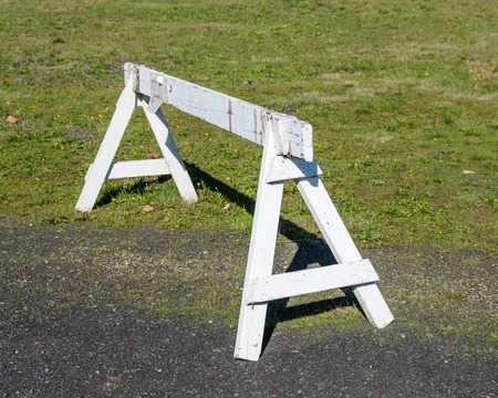 barrier: A saw horse or wooden barrier to control traffic