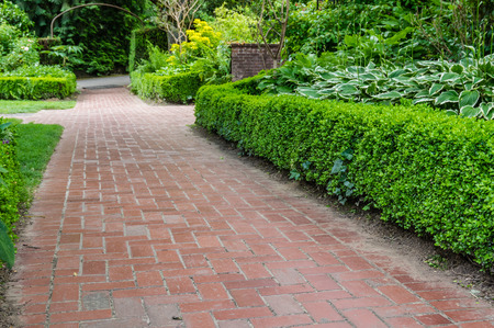 planted: Brick pathways inside a large planted garden
