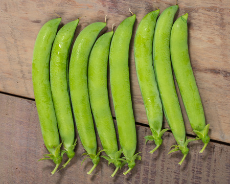 organics: Group of fresh green pea pods on a table