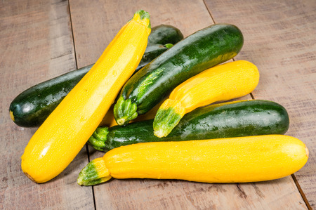 Zucchini and yellow squash on a wooden table Stock Photo