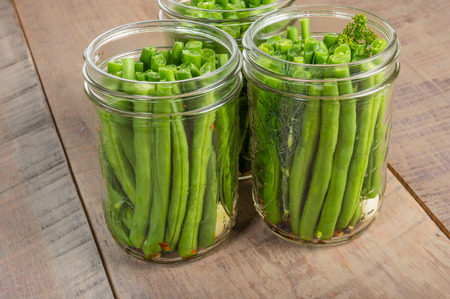 snap bean: Fresh green beans in mason jars ready to be preserved