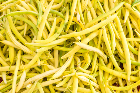 snap bean: Fresh yellow snap beans on display at the farmers market
