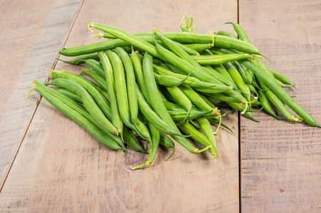 Freshly picked green or snap beans on a wooden table Stock Photo