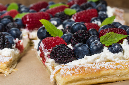Fresh homemade berry tart cut into squares Banco de Imagens
