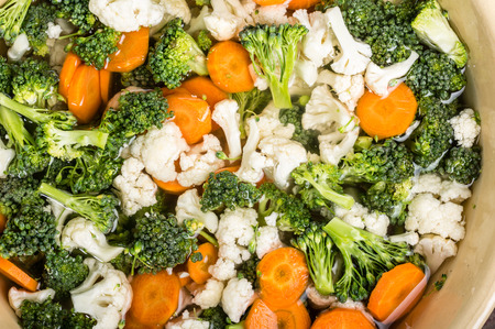 brine: Bowl of fresh cut vegetables in brine for preserving Stock Photo