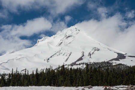mt hood national forest: Mt Hood with white clouds and blowing snow from the crest Stock Photo