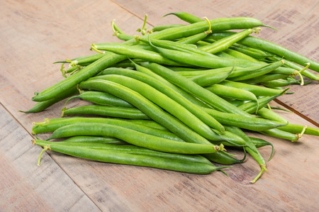 snap bean: Freshly picked green or snap beans on a wooden table Stock Photo