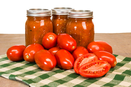 Jars of fresh tomato sauce with red paste tomatoes