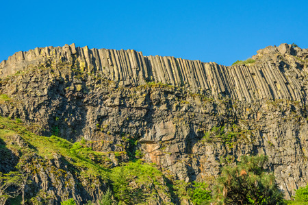 steep cliff: Steep cliff with organ pipe rock formation Stock Photo