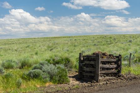 fenceline: Rural praire with fenceline and rock post