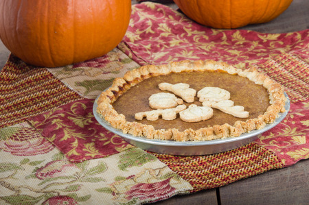 outs: Pumpkin pie decorated with dough cut outs