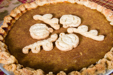 outs: Baked fresh filled pumpkin pie with dough cut outs