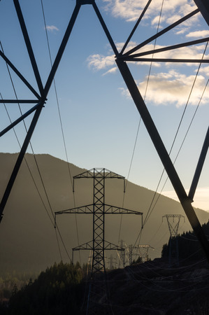 electric grid: Dawn view through a line of transmission towers
