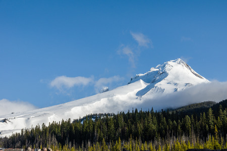 mt hood national forest: Snow covered Mt Hood with blue sky and cloud Stock Photo