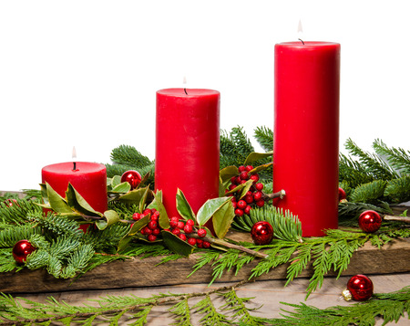 boughs: Red candles in a centerpiece of boughs