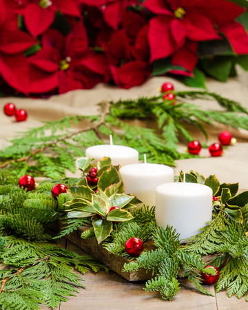 boughs: A Christmas centerpiece with white candles and boughs Stock Photo