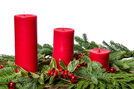 boughs: Red candles in a centerpiece of boughs and holly berries Stock Photo