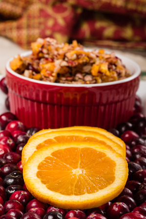 Orange slices on a plate with relish and fresh cranberries Stock Photo