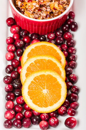 Overhead view of fresh cranberries and cranberry relish