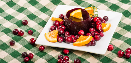 Plate of fresh cranberry sauce with whole red cranberries