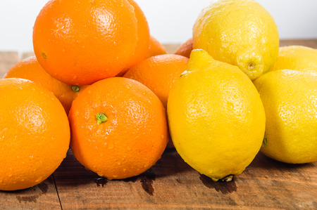 Orange and lemon citrus fruit on a wooden table