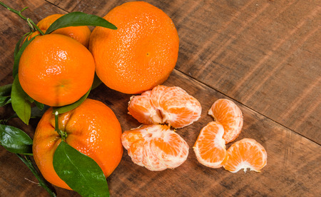 Ripe tangelos with sections of fruit Stock Photo