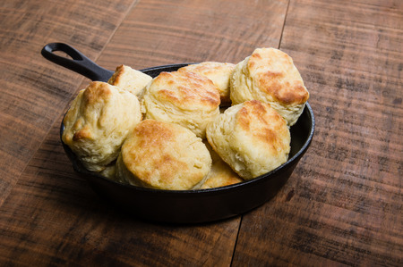cast iron: Fresh baked biscuits baked in a cast iron skillet Stock Photo