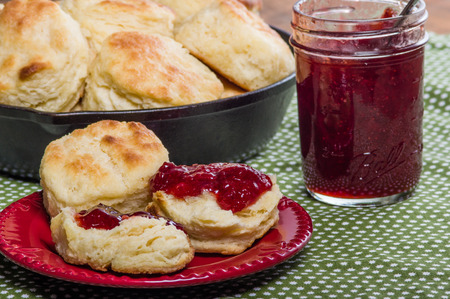 scones: Cast iron skillet of fresh biscuits or scones with jam or jelly