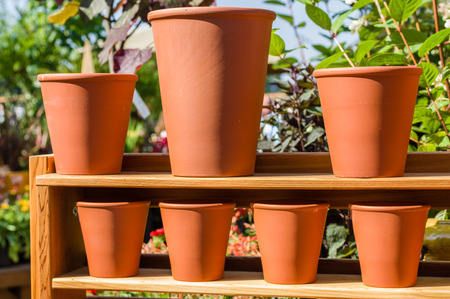 Garden pots of clay on a wooden shelf