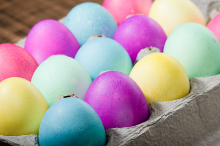 egg carton: Paper egg carton of colorful naturally dyed Easter eggs Stock Photo