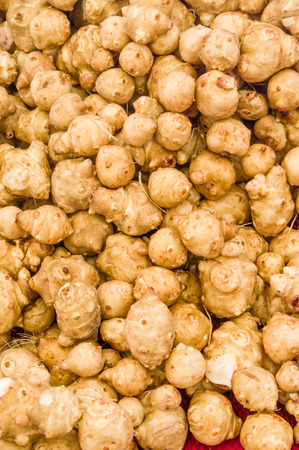 jerusalem artichoke: Display of Jerusalem artichoke tubers at the market Stock Photo