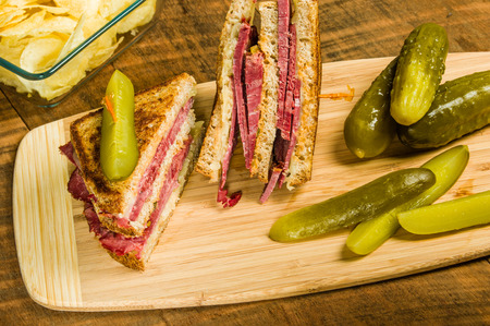 reuben: Grilled reuben sandwich with dill pickle spears