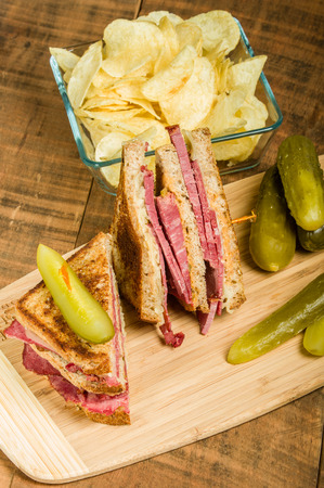 Grilled reuben sandwich with dill pickle spears