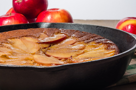 cast iron red: Cast iron skillet apple cake with apples and apple slices