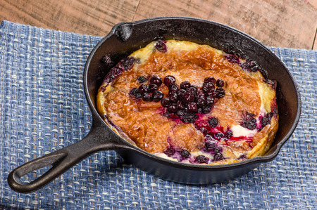 cast iron: Cast iron skillet with blueberry croissant breakfast